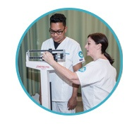 instructor uses patient weight scales on Unitek nursing student