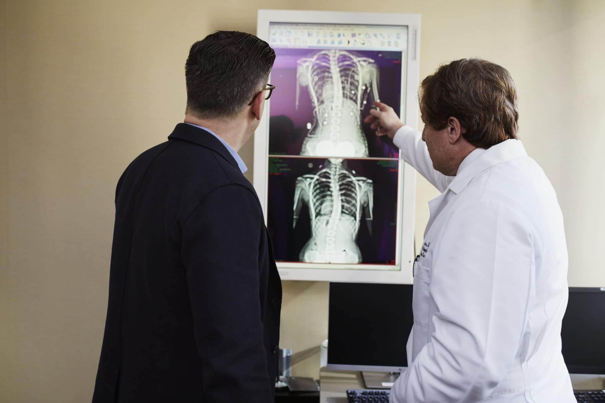Professionals looking at X-rays