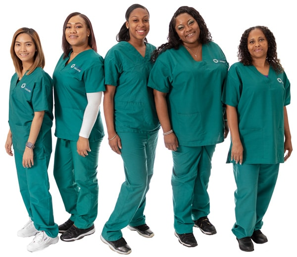 Five students in green scrubs