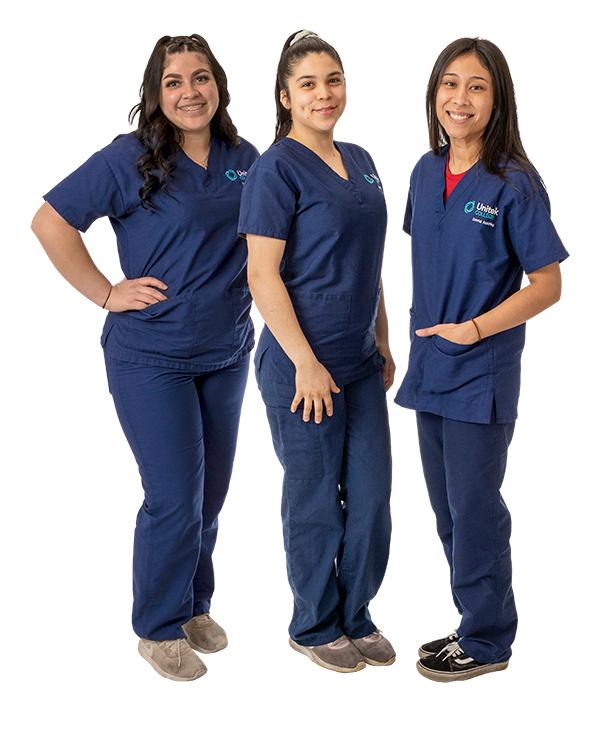 Three students in blue scrubs