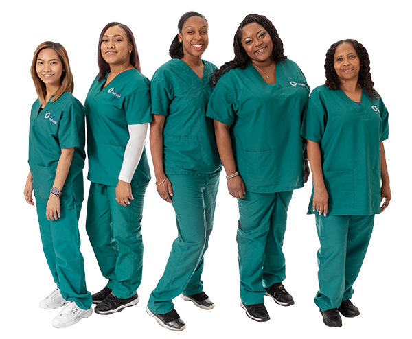 Five nursing students in green scrubs