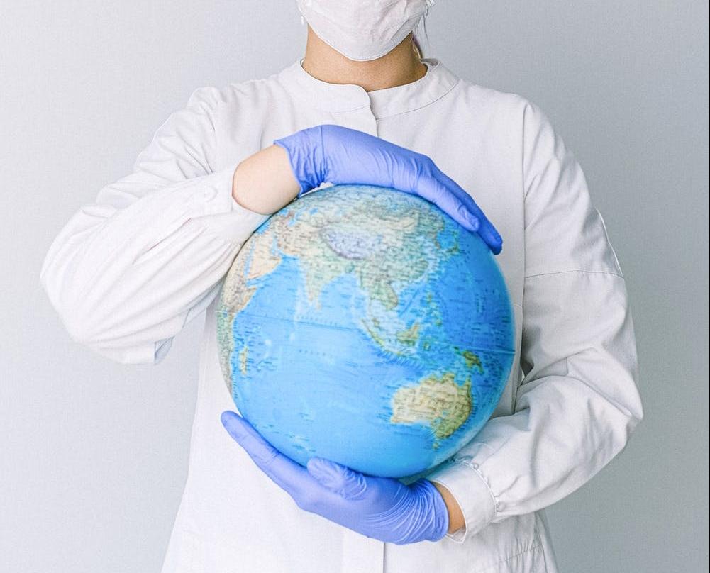 Nurse holding a globe