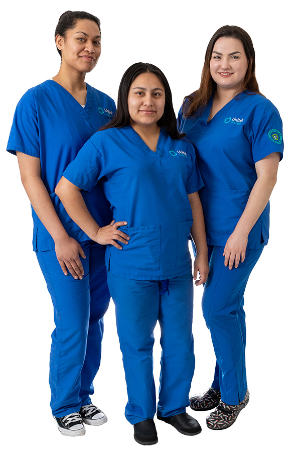 Three nursing students in blue scrubs