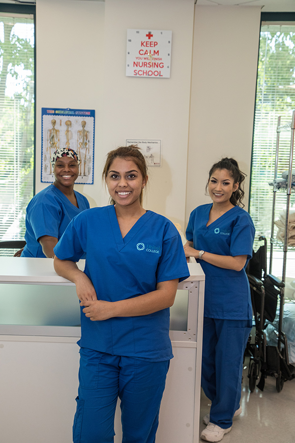 Three nursing students on campus