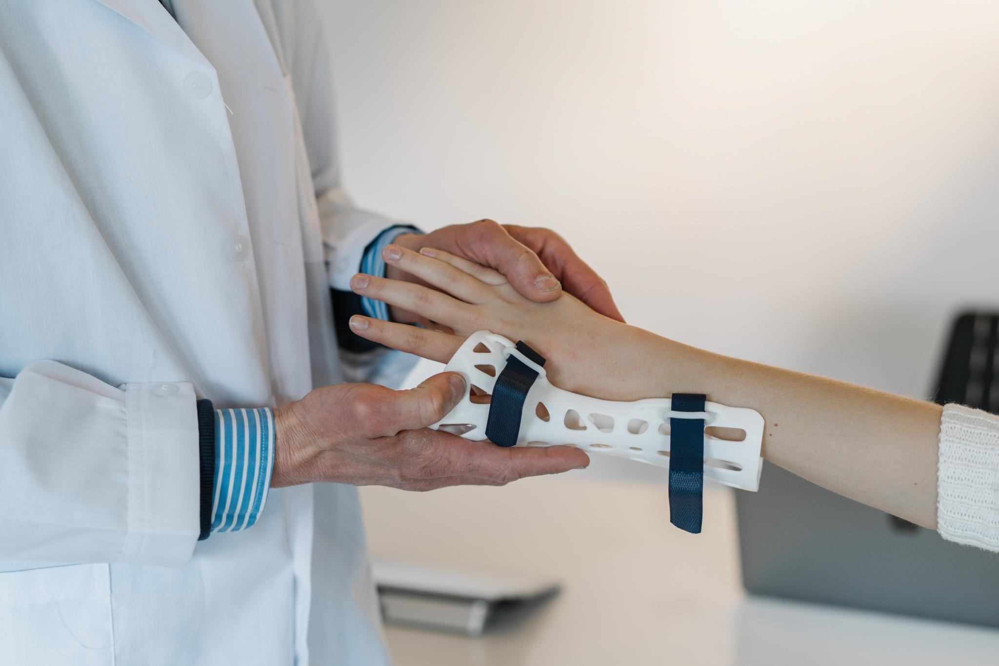 Medical professional applying a splint