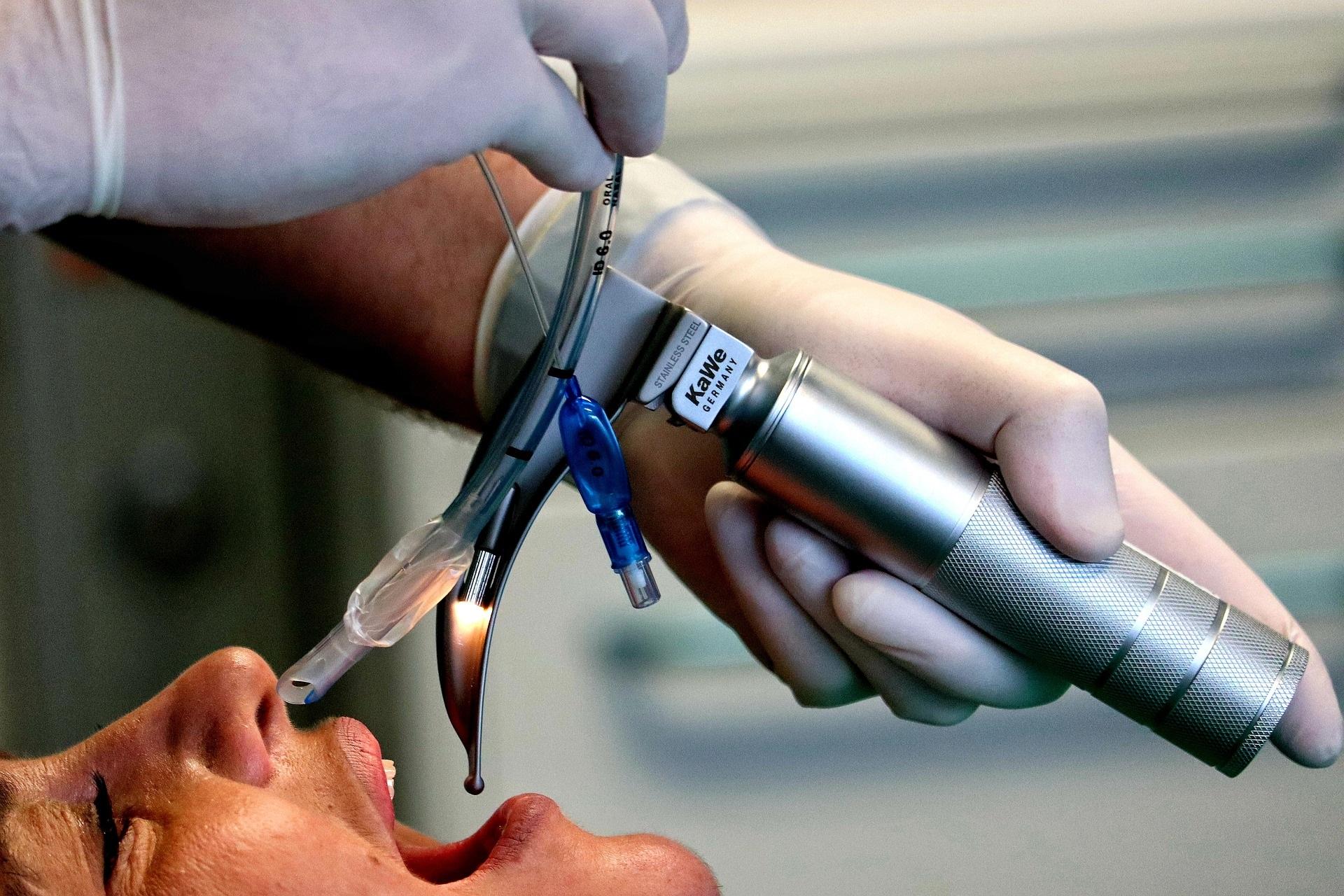 Healthcare professional using a laryngoscope