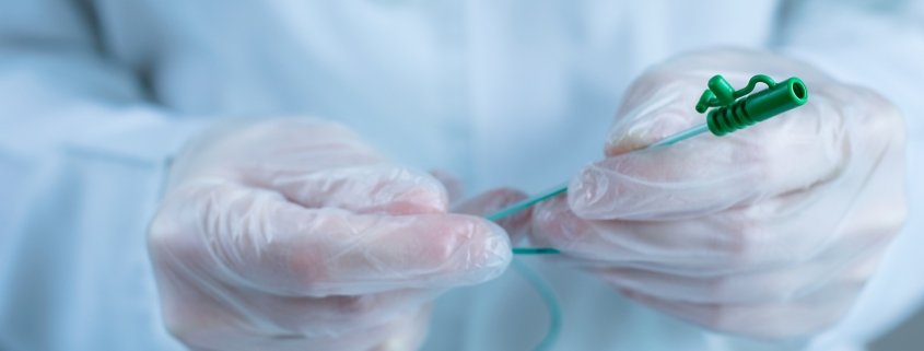 Close up of a catheter in gloved hands