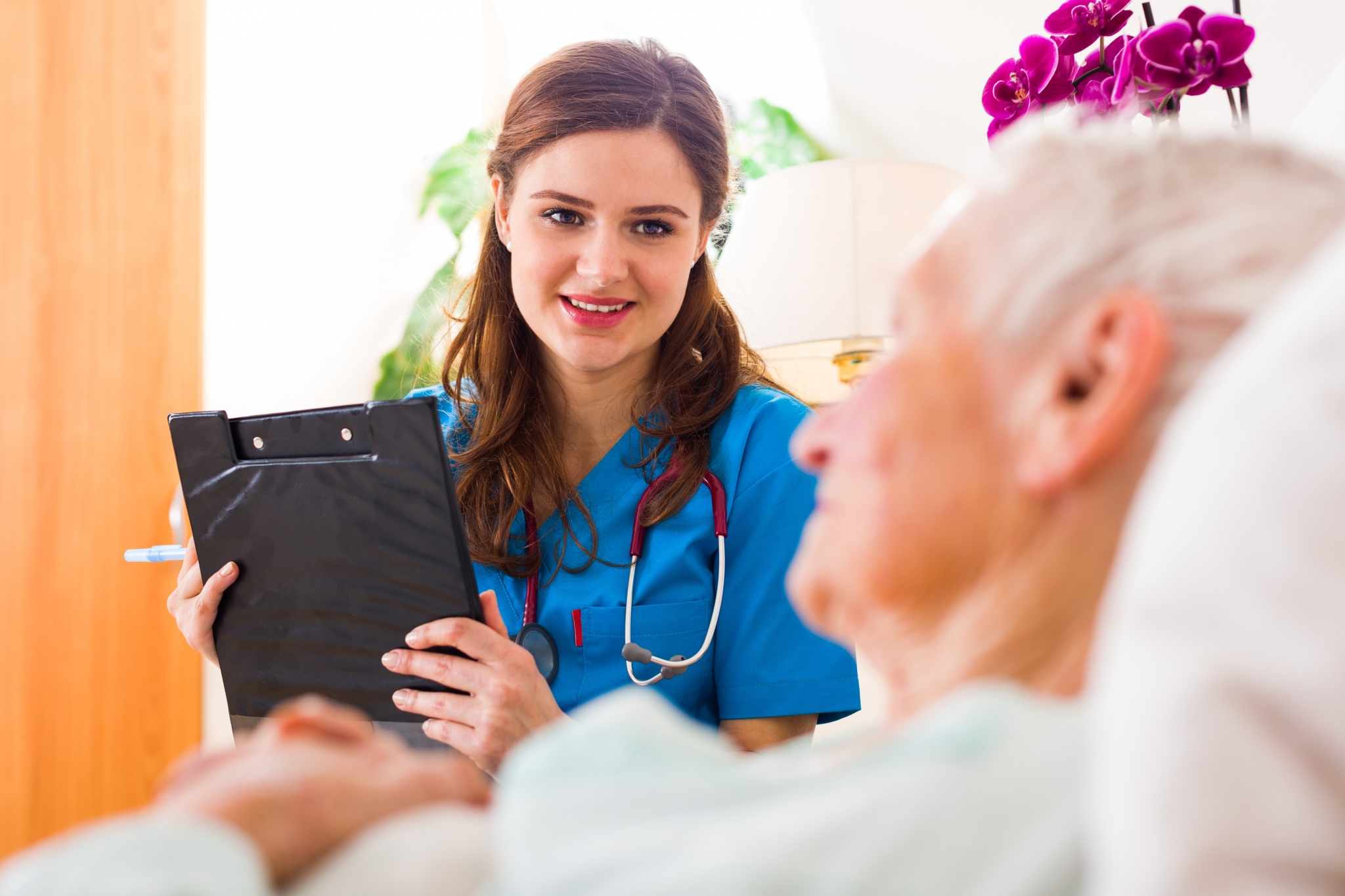 Registered Nurse smiling at a patient
