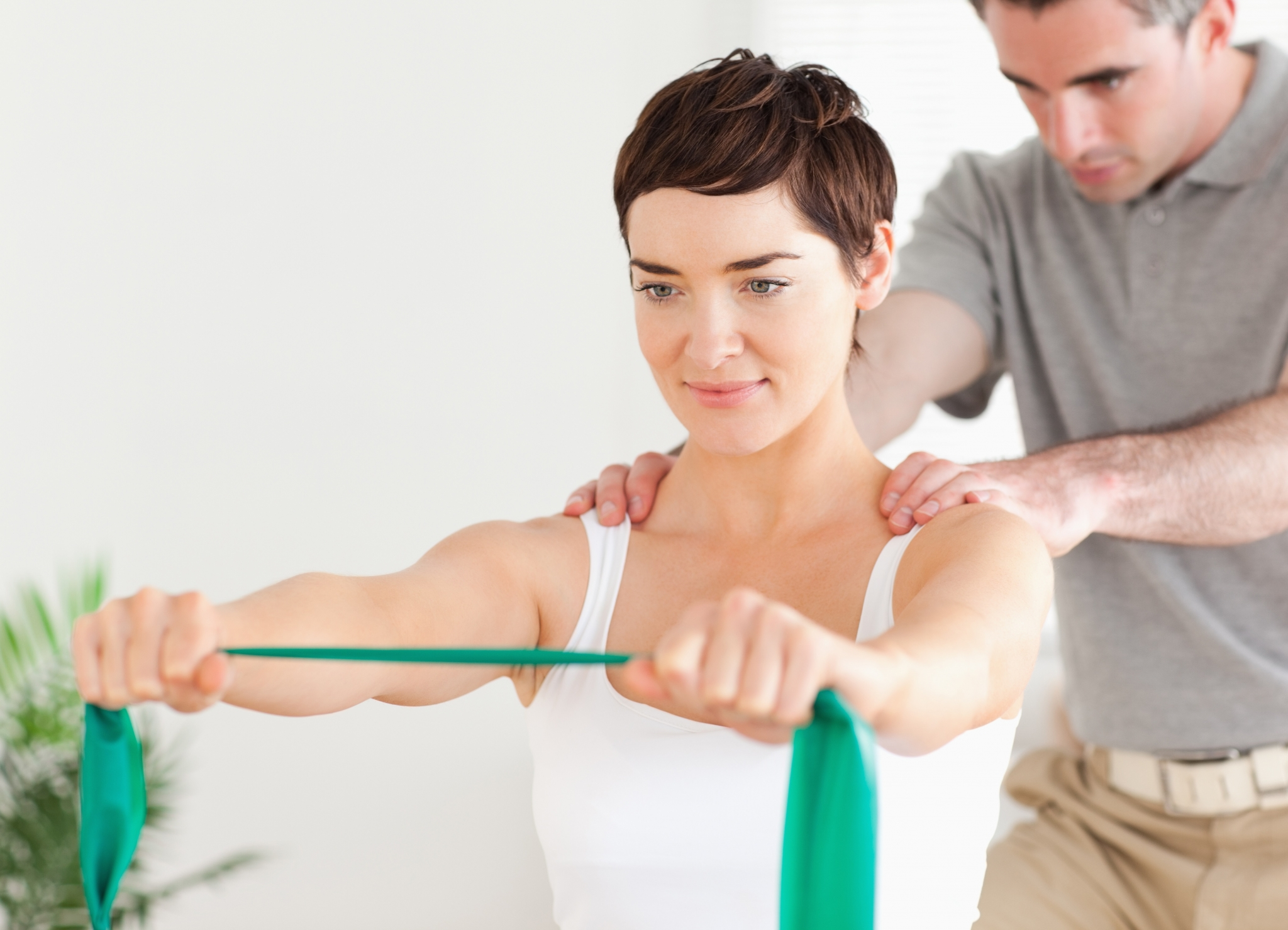 Woman using exercise bands